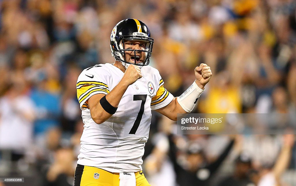 Ben Roethlisberger #7 of the Pittsburgh Steelers reacts after a touchdown in the first half during the game against the Carolina Panthers at Bank of America Stadium on September 21, 2014 in Charlotte, North Carolina. The touchdown was later overturned.
