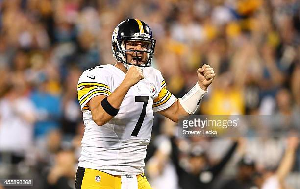 Ben Roethlisberger of the Pittsburgh Steelers reacts after a touchdown in the first half during the game against the Carolina Panthers at Bank of...