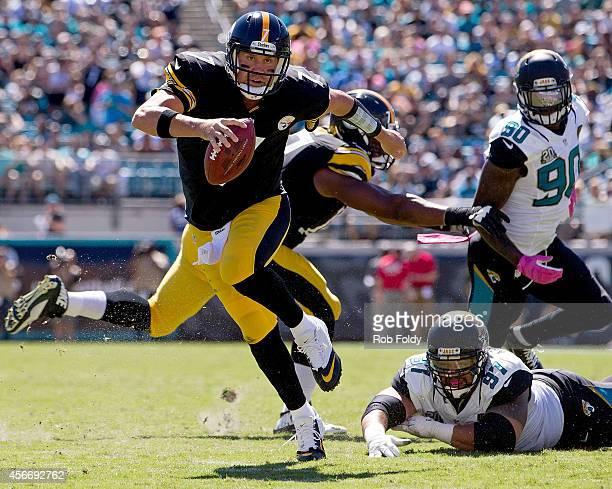 Ben Roethlisberger of the Pittsburgh Steelers scrambles after avoiding a tackle by Roy Miller of the Jacksonville Jaguars during the second quarter...