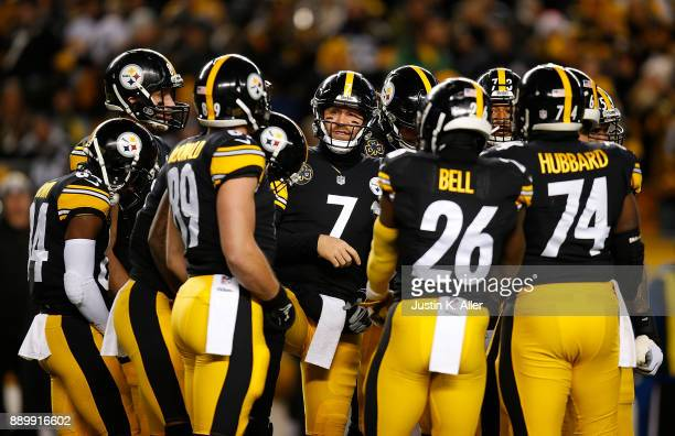 Ben Roethlisberger of the Pittsburgh Steelers talks to the team in the huddle in the first quarter during the game against the Baltimore Ravens at...