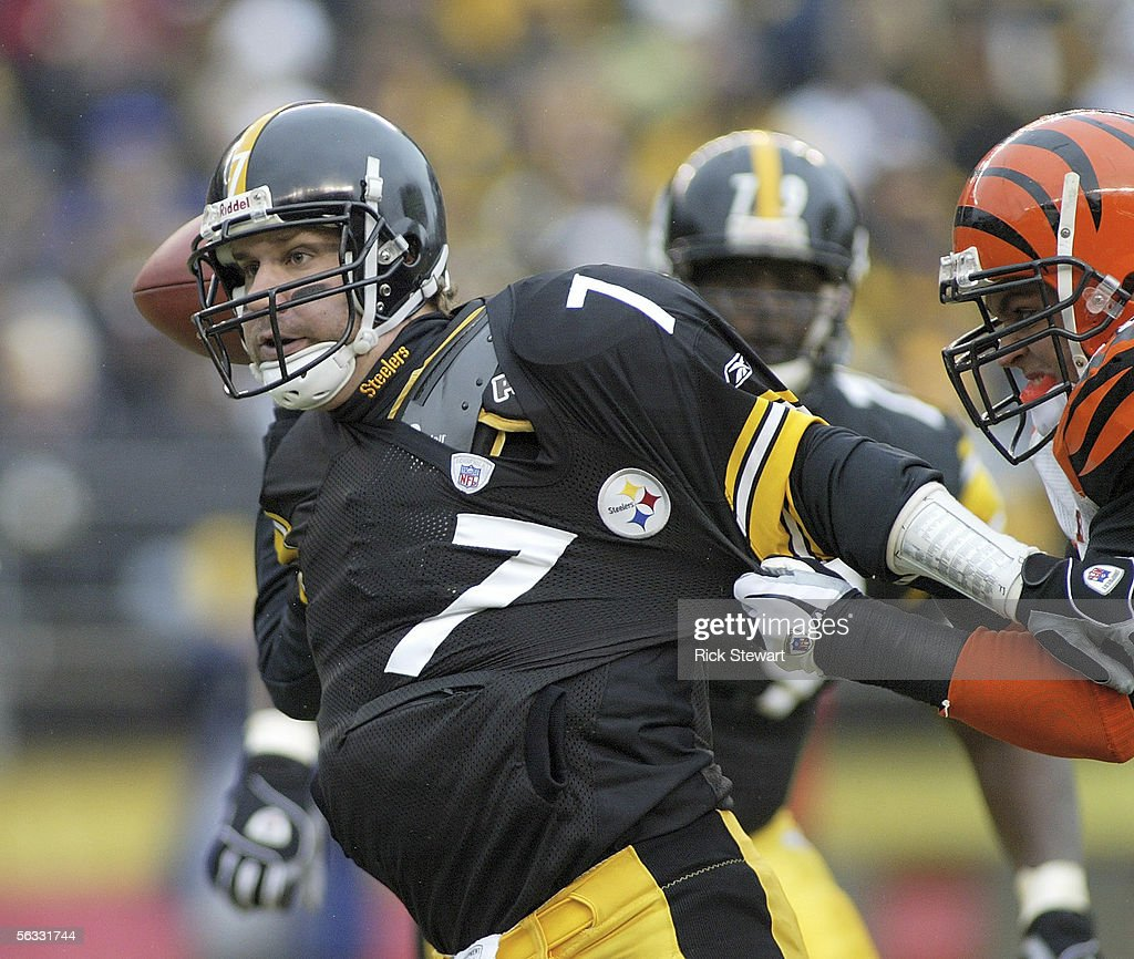 Ben Roethlisberger of the Pittsburgh Steelers tries to throw a pass while in the grasp of David Pollack of the Cincinnati Bengals on December 4 2005...