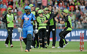 Ben Rohrer and Chris Hartley of the Thunder celebrates with team mates after taking the wicket of Mahela Jayawardena of the Strikers by runout during...
