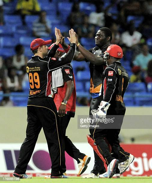 Ben Rohrer of Antigua Hawksbills gives Rahkeem Cornwall a high five for taking two St Lucia Zouks wickets during the Seventeenth Match of the...