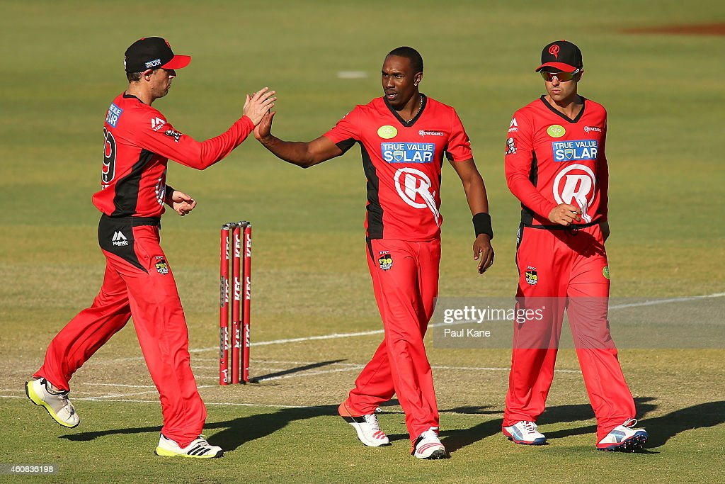 Ben Rohrer of the Renegades congratulates <a gi-track='captionPersonalityLinkClicked' href=/galleries/search?phrase=Dwayne+Bravo&family=editorial&specificpeople=178945 ng-click='$event.stopPropagation()'>Dwayne Bravo</a> after dismissing <a gi-track='captionPersonalityLinkClicked' href=/galleries/search?phrase=Michael+Carberry&family=editorial&specificpeople=600686 ng-click='$event.stopPropagation()'>Michael Carberry</a> of the Scorchers during the Big Bash League match between the Perth Scorchers and the Melbourne Renegades at WACA on December 26, 2014 in Perth, Australia.