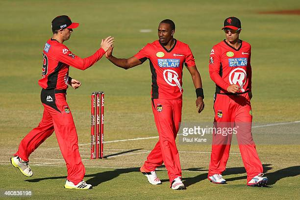 Ben Rohrer of the Renegades congratulates Dwayne Bravo after dismissing Michael Carberry of the Scorchers during the Big Bash League match between...