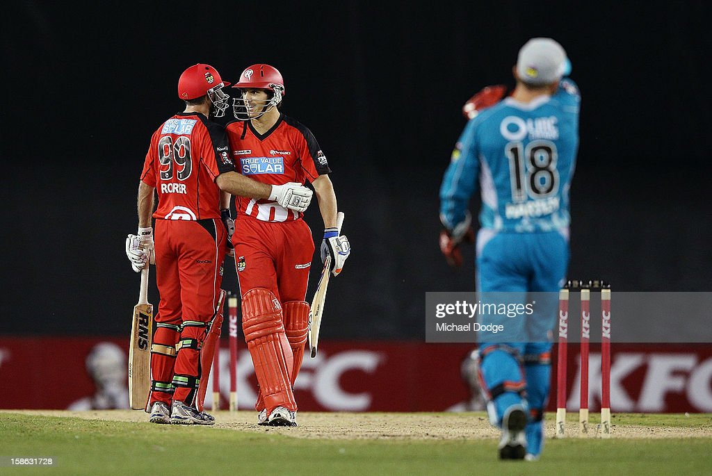 Ben Rohrer (L) of the Renegades hits the winning runs and celebrates with Will Sheridan during the Big Bash League match between the Melbourne Renegades and the Brisbane Heat at Etihad Stadium on December 22, 2012 in Melbourne, Australia.