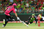 Ben Rohrer of the Thunder attempts to run out Michael Lumb of the Sixers during the Big Bash League match between the Sydney Thunder and the Sydney...