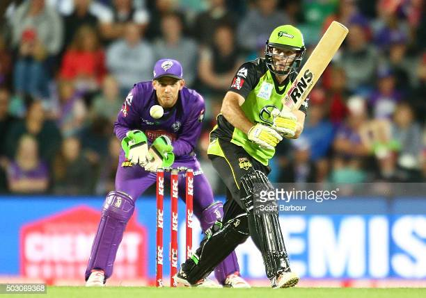Ben Rohrer of the Thunder bats as wicketkeeper Tim Paine of the Hurricanes looks on during the Big Bash League match between the Hobart Hurricanes...