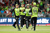 Ben Rohrer of the Thunder celebrates with team mates after running out Michael Neser of the Strikers during the Big Bash League match between the...