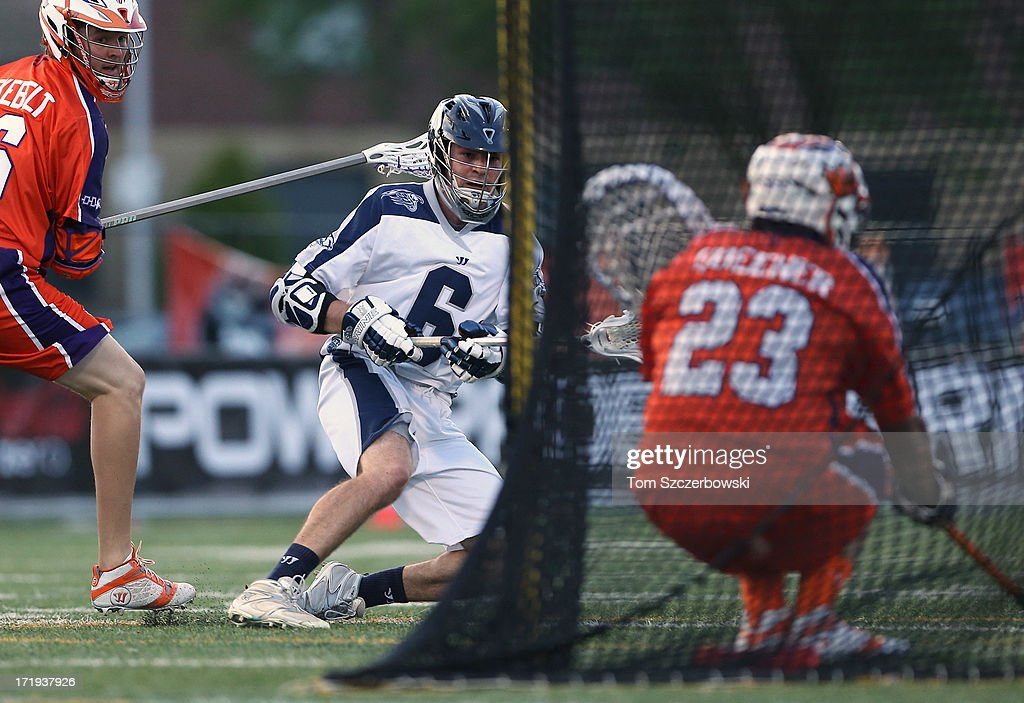 <a gi-track='captionPersonalityLinkClicked' href=/galleries/search?phrase=Ben+Rubeor&family=editorial&specificpeople=6681732 ng-click='$event.stopPropagation()'>Ben Rubeor</a> #6 of the Chesapeake Bayhawks scores a goal during Major League Lacrosse game action past <a gi-track='captionPersonalityLinkClicked' href=/galleries/search?phrase=Brett+Queener&family=editorial&specificpeople=5984070 ng-click='$event.stopPropagation()'>Brett Queener</a> #23 of the Hamilton Nationals on June 29, 2013 at Ron Joyce Stadium in Hamilton, Ontario, Canada.