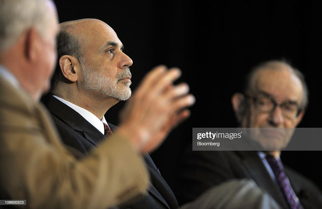 Ben S. Bernanke, chairman of the U.S. Federal Reserve, center, and former Fed Chairman <a gi-track='captionPersonalityLinkClicked' href=/galleries/search?phrase=Alan+Greenspan&family=editorial&specificpeople=157526 ng-click='$event.stopPropagation()'>Alan Greenspan</a>, right, listen to E. Gerald Corrigan, chairman of Goldman Sachs Group Inc.'s bank subsidiary, at a conference on the history of the Fed in Jekyll Island, Georgia, U.S., on Saturday, Nov. 6, 2010. Bernanke, adding to his defense of this week's expansion of record monetary stimulus, dismissed the idea the central bank will increase inflation higher than it prefers. Photographer: Stephen Morton/Bloomberg via Getty Images
