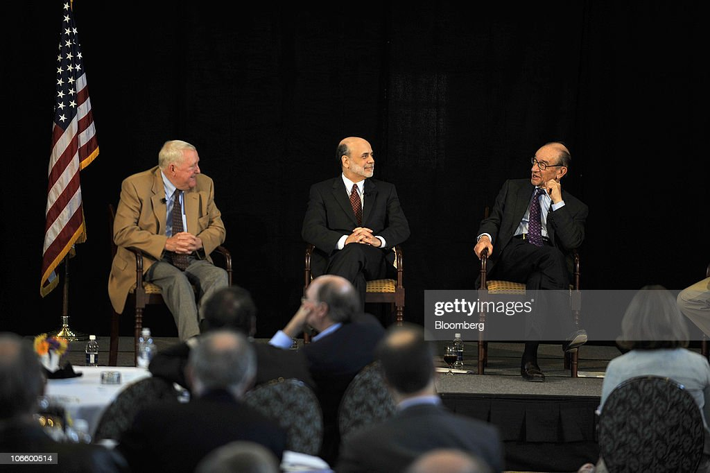 Ben S. Bernanke, chairman of the U.S. Federal Reserve, center, listens to former Fed Chairman <a gi-track='captionPersonalityLinkClicked' href=/galleries/search?phrase=Alan+Greenspan&family=editorial&specificpeople=157526 ng-click='$event.stopPropagation()'>Alan Greenspan</a>, right, during a discussion with E. Gerald Corrigan, chairman of Goldman Sachs Group Inc.'s bank subsidiary, at a conference on the history of the Fed in Jekyll Island, Georgia, U.S., on Saturday, Nov. 6, 2010. Bernanke, adding to his defense of this week's expansion of record monetary stimulus, dismissed the idea the central bank will increase inflation higher than it prefers. Photographer: Stephen Morton/Bloomberg via Getty Images