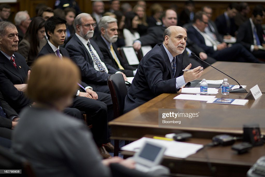 Ben S. Bernanke, chairman of the U.S. Federal Reserve, center right, speaks during a House Financial Services Committee hearing in Washington, D.C., U.S., on Wednesday, Feb. 27, 2013. Bernanke signaled the Fed is prepared to keep buying bonds at its present pace as he dismissed concerns record easing risks sparking inflation or fueling asset price bubbles. Photographer: Andrew Harrer/Bloomberg via Getty Images