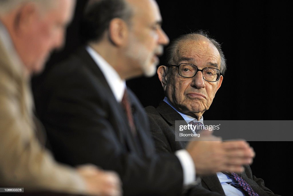 Ben S. Bernanke, chairman of the U.S. Federal Reserve, center, speaks during a discussion with former Fed Chairman <a gi-track='captionPersonalityLinkClicked' href=/galleries/search?phrase=Alan+Greenspan&family=editorial&specificpeople=157526 ng-click='$event.stopPropagation()'>Alan Greenspan</a>, right, and E. Gerald Corrigan, chairman of Goldman Sachs Group Inc.'s bank subsidiary, at a conference on the history of the Fed in Jekyll Island, Georgia, U.S., on Saturday, Nov. 6, 2010. Bernanke, adding to his defense of this week's expansion of record monetary stimulus, dismissed the idea the central bank will increase inflation higher than it prefers. Photographer: Stephen Morton/Bloomberg via Getty Images
