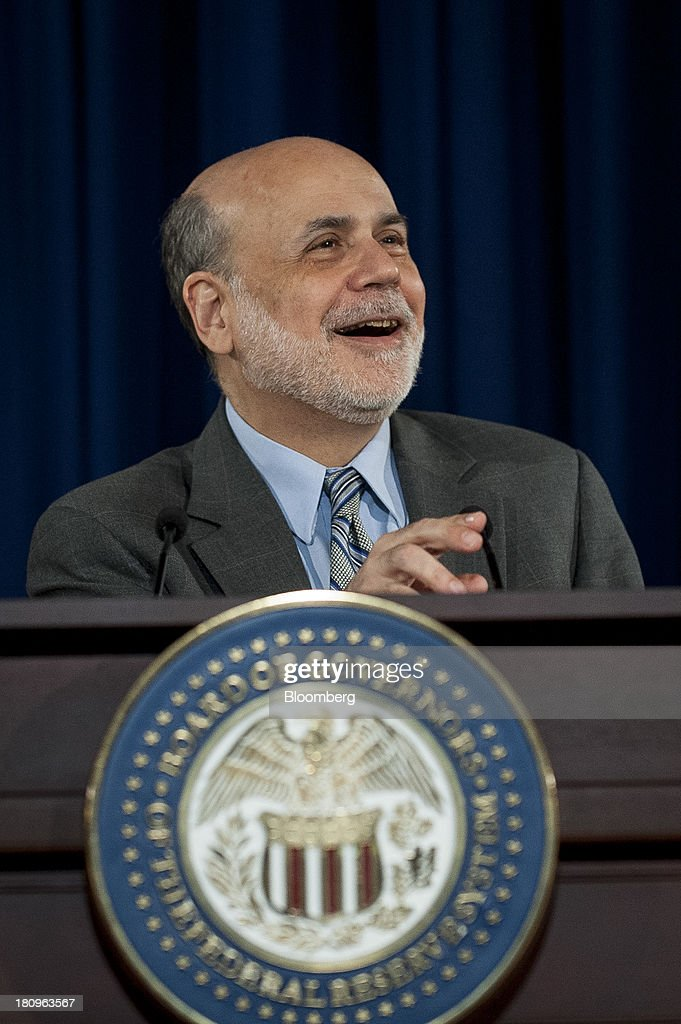 Ben S. Bernanke, chairman of the U.S. Federal Reserve, laughs during a news conference following the Federal Open Market Committee meeting in Washington, D.C., U.S., on Wednesday, Sept. 18, 2013. The Federal Reserve unexpectedly refrained from reducing the $85 billion pace of monthly bond buying, saying it needs to see more signs of lasting improvement in the economy. Photographer: Pete Marovich/Bloomberg via Getty Images