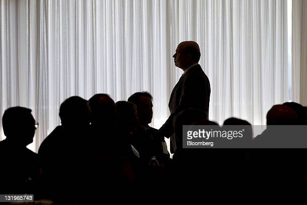 Ben S Bernanke chairman of the US Federal Reserve leaves after speaking at a small business and entrepreneurship conference in Washington DC US on...