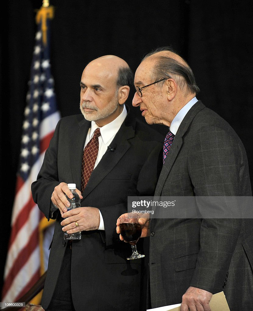 Ben S. Bernanke, chairman of the U.S. Federal Reserve, left, and former Fed Chairman <a gi-track='captionPersonalityLinkClicked' href=/galleries/search?phrase=Alan+Greenspan&family=editorial&specificpeople=157526 ng-click='$event.stopPropagation()'>Alan Greenspan</a>, chat before taking the stage at a conference on the history of the Fed in Jekyll Island, Georgia, U.S., on Saturday, Nov. 6, 2010. Bernanke, adding to his defense of this week's expansion of record monetary stimulus, dismissed the idea the central bank will increase inflation higher than it prefers. Photographer: Stephen Morton/Bloomberg via Getty Images