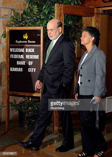 Ben S Bernanke chairman of the US Federal Reserve left speaks with Susan M Collins the dean of public policy at the University of Michigan at the...