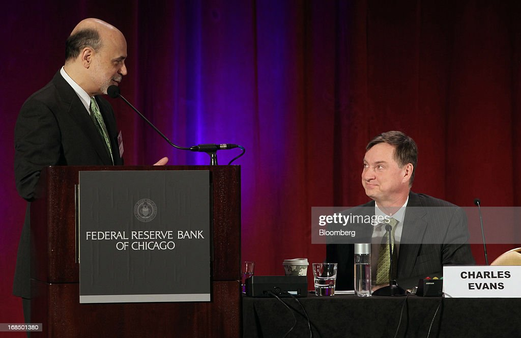 Ben S. Bernanke, chairman of the U.S. Federal Reserve, left, speaks with Charles Evans, president and chief executive officer of the Federal Reserve Bank of Chicago, during the 49th Annual Conference on Bank Structure and Competition in Chicago, Illinois, U.S., on Friday, May 10, 2013. Bernanke said risks persist in wholesale funding markets used frequently by Wall Street brokers to finance securities trading. Photographer: Tim Boyle/Bloomberg via Getty Images