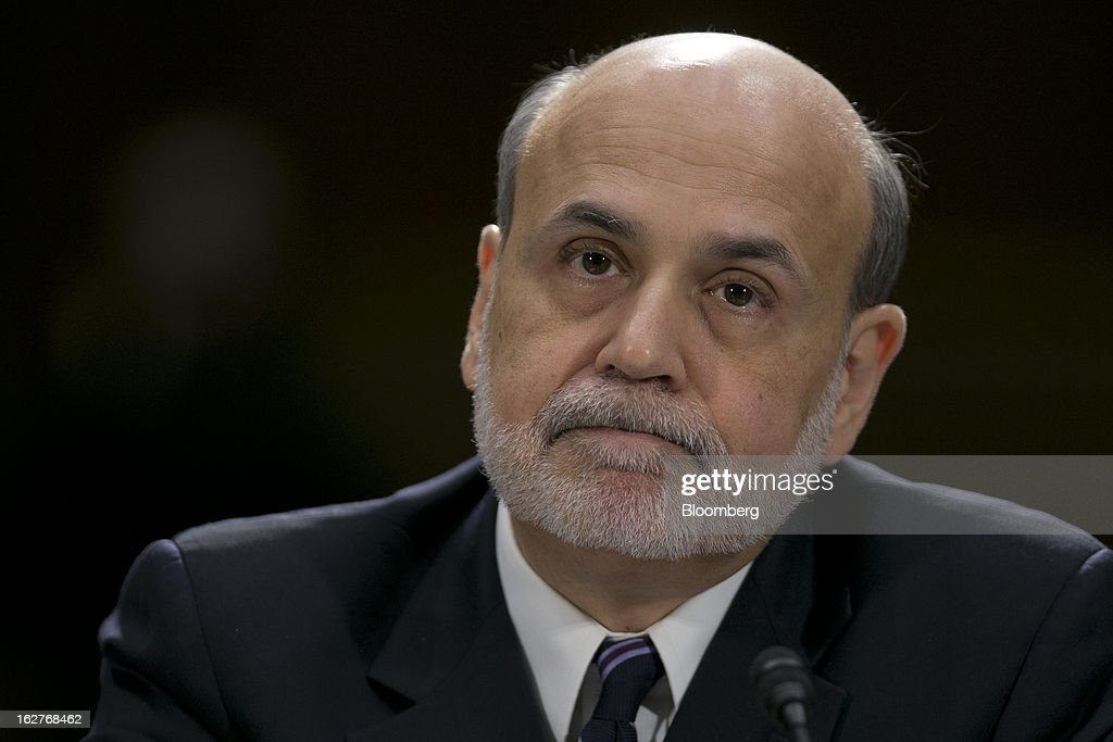 Ben S. Bernanke, chairman of the U.S. Federal Reserve, listens during a Senate Banking Committee hearing in Washington, D.C., U.S., on Tuesday, Feb. 26, 2013. Bernanke defended the central bank's unprecedented asset purchases, saying they are supporting the expansion with little risk of inflation or asset-price bubbles. Photographer: Andrew Harrer/Bloomberg via Getty Images