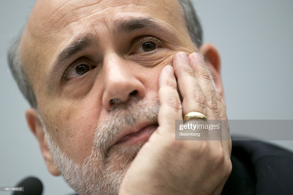 Ben S. Bernanke, chairman of the U.S. Federal Reserve, listens during a House Financial Services Committee hearing in Washington, D.C., U.S., on Wednesday, Feb. 27, 2013. Bernanke signaled the Fed is prepared to keep buying bonds at its present pace as he dismissed concerns record easing risks sparking inflation or fueling asset price bubbles. Photographer: Andrew Harrer/Bloomberg via Getty Images