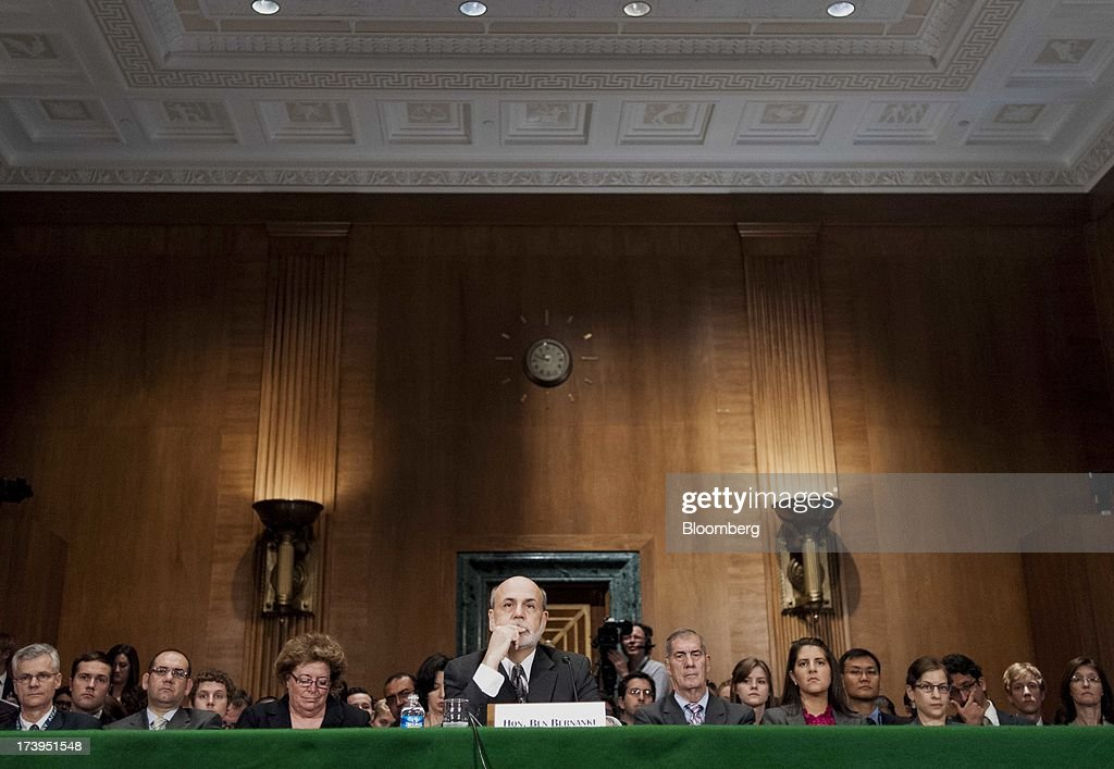 Ben S. Bernanke, chairman of the U.S. Federal Reserve, listens during his semi-annual monetary policy report to the Senate Banking, Housing, and Urban Affairs Committee in Washington, D.C., U.S., on Thursday, July 18, 2013. Bernanke said one reason for the recent rise in long-term interest rates is the unwinding of leveraged and 'excessively risky' investing. Photographer: Pete Marovich/Bloomberg via Getty Images