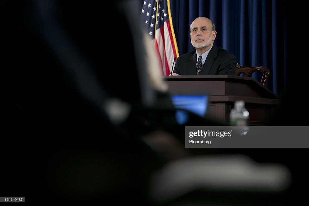 Ben S. Bernanke, chairman of the U.S. Federal Reserve, listens to a question during a news conference following a Federal Open Market Committee (FOMC) meeting in Washington, D.C., U.S., on Wednesday, March 20, 2013. The Federal Reserve will keep up its bond buying at a pace of $85 billion a month even as the world's largest economy and the job market pick up. Photographer: Andrew Harrer/Bloomberg via Getty Images