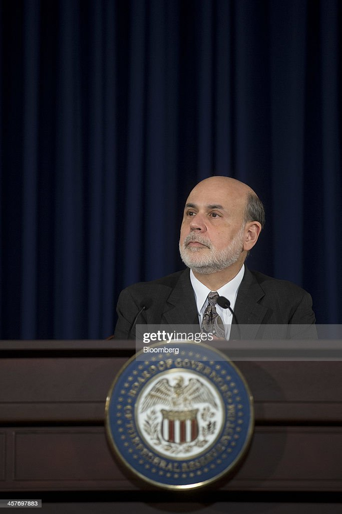Ben S. Bernanke, chairman of the U.S. Federal Reserve, listens to a question during a news conference following a Federal Open Market Committee (FOMC) meeting in Washington, D.C., U.S., on Wednesday, Dec. 18, 2013. The Federal Reserve is cutting its monthly bond purchases to $75 billion from $85 billion, taking its first step toward unwinding the unprecedented stimulus that Bernanke put in place to help the economy recover from the worst recession since the 1930s. Photographer: Andrew Harrer/Bloomberg via Getty Images