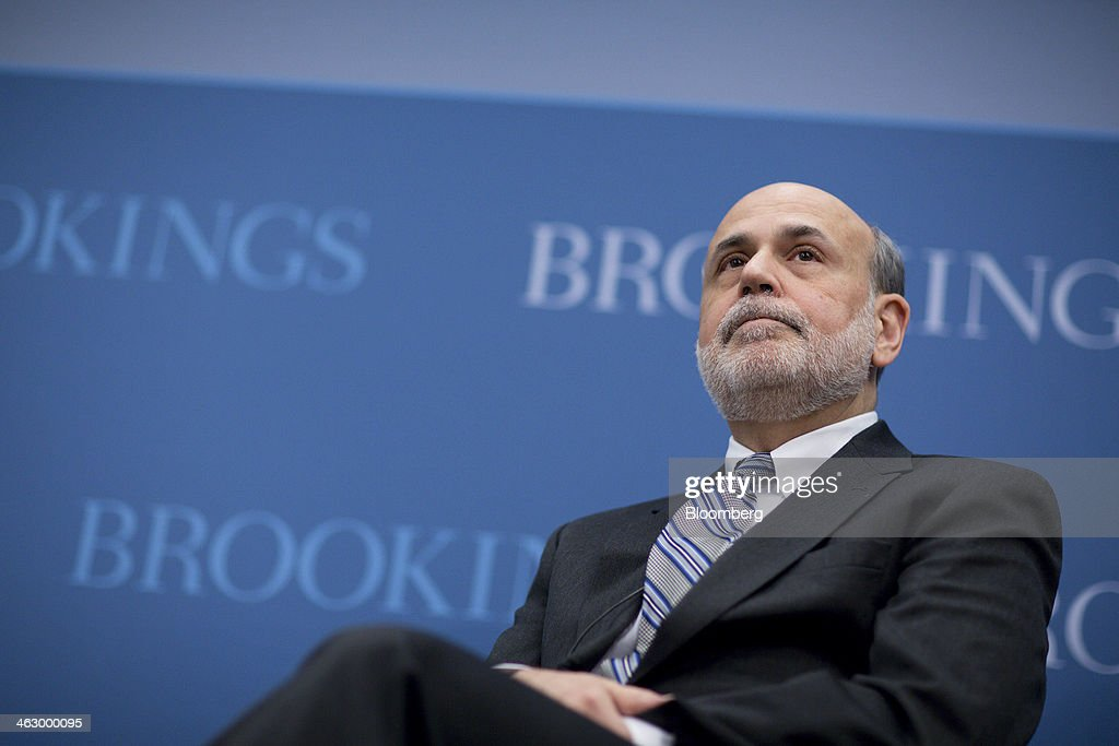Ben S. Bernanke, chairman of the U.S. Federal Reserve, listens to a question during a discussion at the Brookings Institution in Washington, D.C., U.S., on Thursday, Jan. 16, 2014. Bernanke defended quantitative easing, saying it has helped the economy while posing little risk of inflation. Photographer: Andrew Harrer/Bloomberg via Getty Images