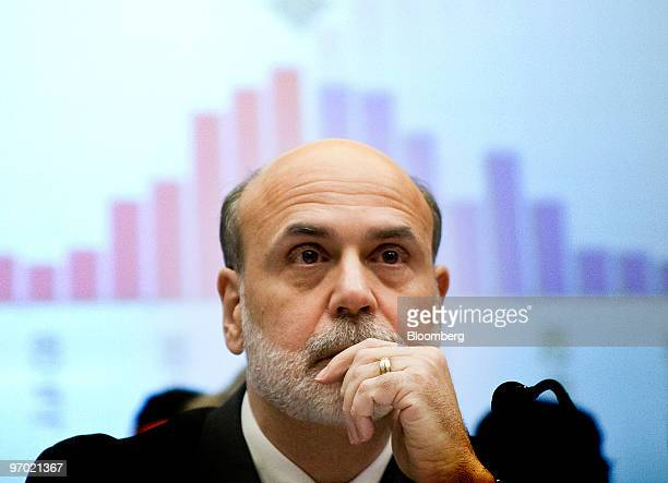 Ben S Bernanke chairman of the US Federal Reserve listens to opening statements before giving his semiannual monetary report to the House Financial...