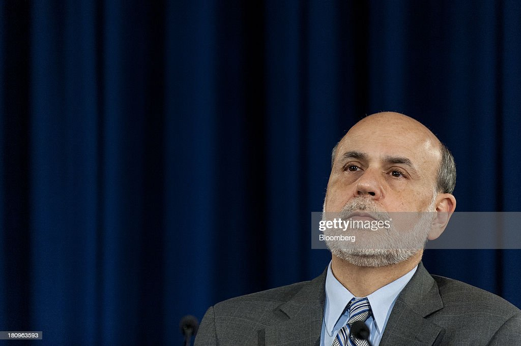 Ben S. Bernanke, chairman of the U.S. Federal Reserve, pauses during a news conference following the Federal Open Market Committee meeting in Washington, D.C., U.S., on Wednesday, Sept. 18, 2013. The Federal Reserve unexpectedly refrained from reducing the $85 billion pace of monthly bond buying, saying it needs to see more signs of lasting improvement in the economy. Photographer: Pete Marovich/Bloomberg via Getty Images