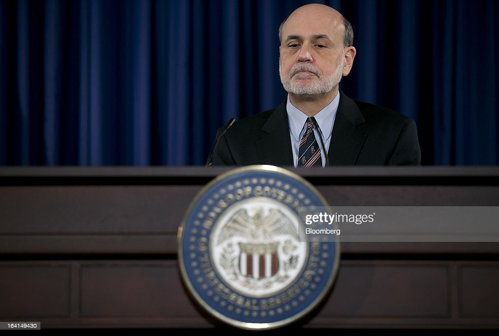 Ben S. Bernanke, chairman of the U.S. Federal Reserve, pauses while speaking during a news conference following a Federal Open Market Committee (FOMC) meeting in Washington, D.C., U.S., on Wednesday, March 20, 2013. The Federal Reserve will keep up its bond buying at a pace of $85 billion a month even as the world's largest economy and the job market pick up. Photographer: Andrew Harrer/Bloomberg via Getty Images