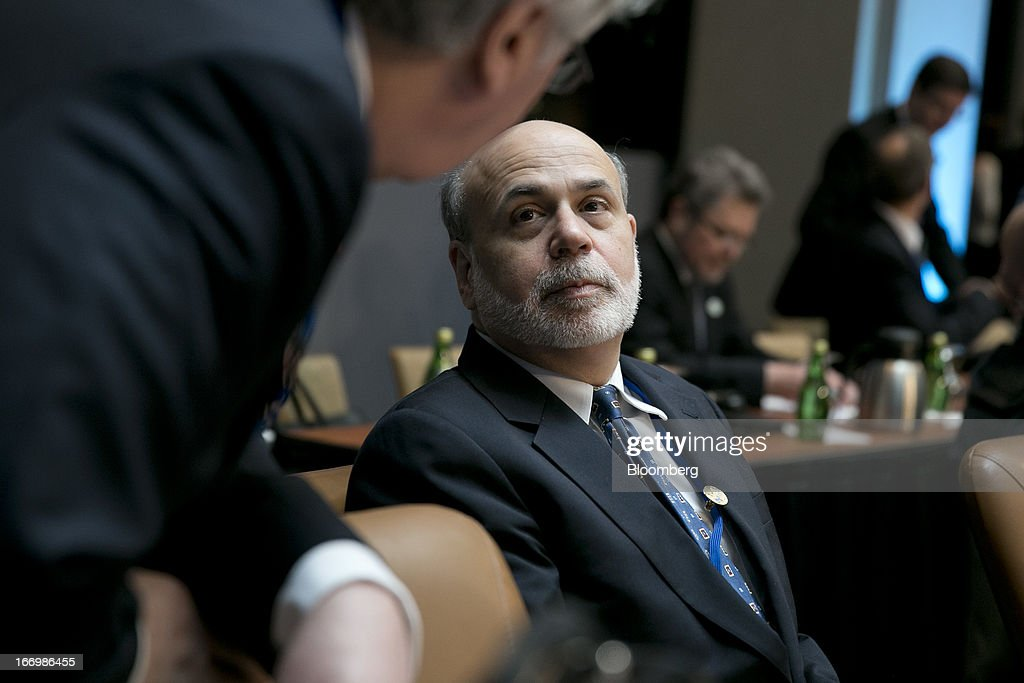 Ben S. Bernanke, chairman of the U.S. Federal Reserve, right, talks to Mervyn King, governor of the Bank of England, during a Group of 20 nations (G- 20) finance ministers and central bank governors meeting on the sidelines of the International Monetary Fund (IMF) and World Bank Group Spring Meetings in Washington, D.C., U.S., on Friday, April 19, 2013. G-20 nations will affirm a commitment to avoid weakening their currencies to gain a trade advantage, according to a draft statement prepared for a meeting this week in Washington. Photographer: Andrew Harrer/Bloomberg via Getty Images