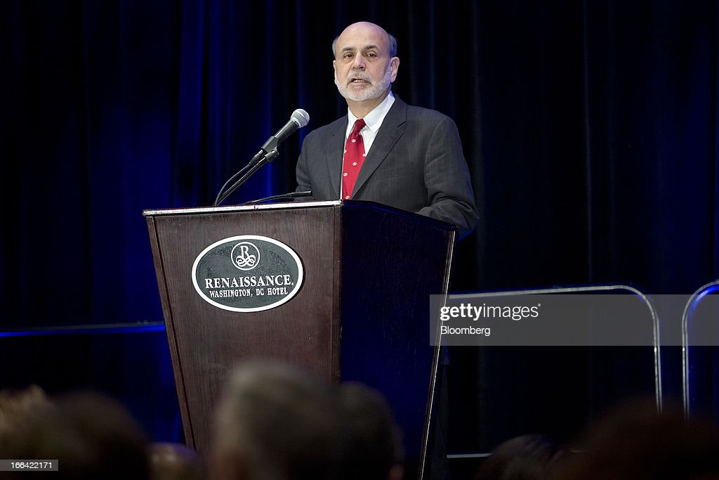 Ben S. Bernanke, chairman of the U.S. Federal Reserve, speaks at a community development research conference sponsored by the Federal Reserve in Washington, D.C., U.S., on Friday, April 12, 2013. Bernanke said aiding low-income neighborhoods requires a 'multipronged' approach focusing on education, jobs and health care as well as housing. Photographer: Andrew Harrer/Bloomberg via Getty Images