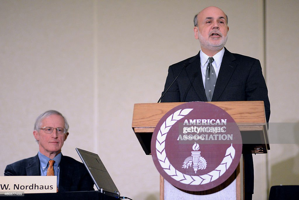 Ben S. Bernanke, chairman of the U.S. Federal Reserve, speaks at the American Economic Association annual meeting in Philadelphia, Pennsylvania, U.S., on Friday, Jan. 3, 2014. Bernanke said the headwinds that have held back the U.S. economy may be abating, leaving the country poised for faster growth as his tenure as Federal Reserve chairman comes to an end. Photographer: William Thomas Cain/Bloomerg
