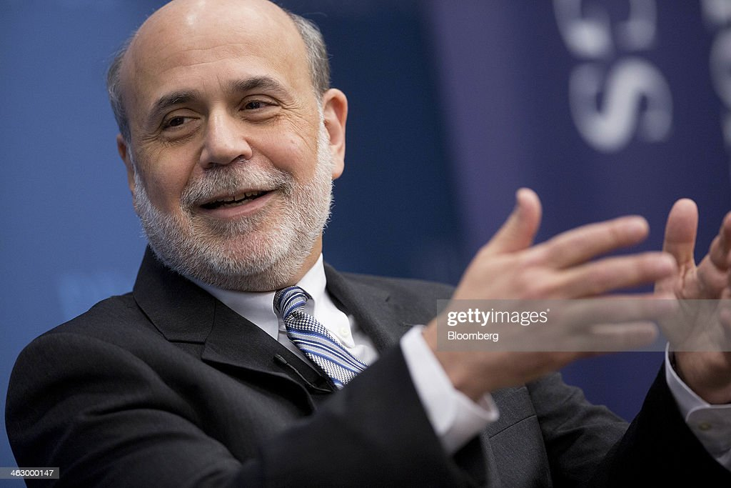 Ben S. Bernanke, chairman of the U.S. Federal Reserve, speaks during a discussion at the Brookings Institution in Washington, D.C., U.S., on Thursday, Jan. 16, 2014. Bernanke defended quantitative easing, saying it has helped the economy while posing little risk of inflation. Photographer: Andrew Harrer/Bloomberg via Getty Images