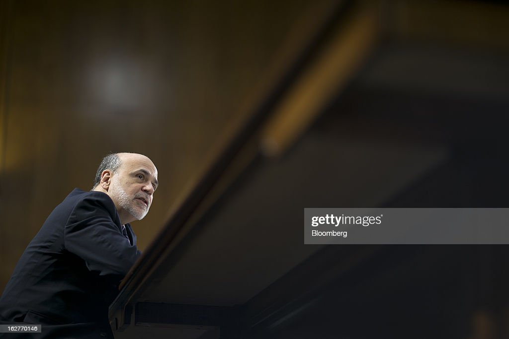 Ben S. Bernanke, chairman of the U.S. Federal Reserve, speaks during a Senate Banking Committee hearing in Washington, D.C., U.S., on Tuesday, Feb. 26, 2013. Bernanke defended the central bank's unprecedented asset purchases, saying they are supporting the expansion with little risk of inflation or asset-price bubbles. Photographer: Andrew Harrer/Bloomberg via Getty Images