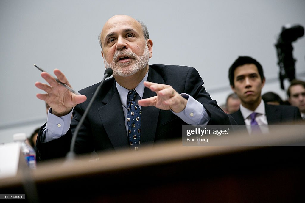Ben S. Bernanke, chairman of the U.S. Federal Reserve, speaks during a House Financial Services Committee hearing in Washington, D.C., U.S., on Wednesday, Feb. 27, 2013. Bernanke signaled the Fed is prepared to keep buying bonds at its present pace as he dismissed concerns record easing risks sparking inflation or fueling asset price bubbles. Photographer: Andrew Harrer/Bloomberg via Getty Images