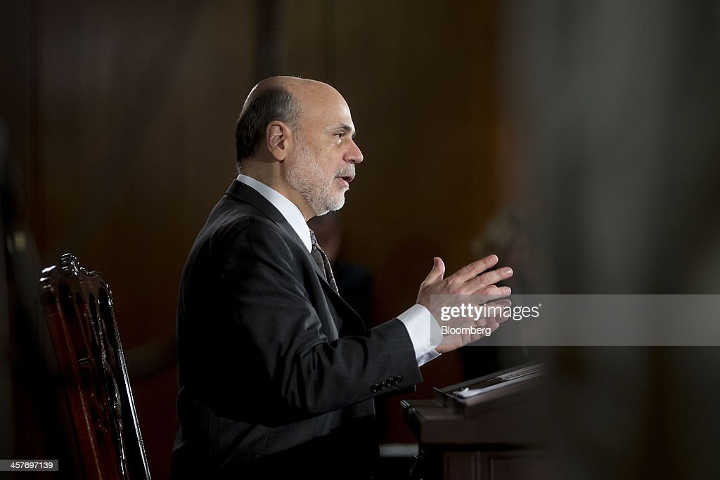 Ben S. Bernanke, chairman of the U.S. Federal Reserve, speaks during a news conference following a Federal Open Market Committee (FOMC) meeting in Washington, D.C., U.S., on Wednesday, Dec. 18, 2013. The Federal Reserve is cutting its monthly bond purchases to $75 billion from $85 billion, taking its first step toward unwinding the unprecedented stimulus that Bernanke put in place to help the economy recover from the worst recession since the 1930s. Photographer: Andrew Harrer/Bloomberg via Getty Images