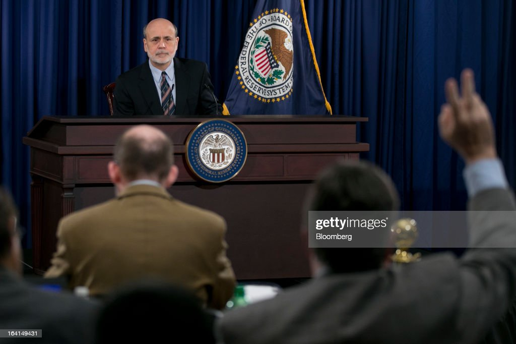 Ben S. Bernanke, chairman of the U.S. Federal Reserve, takes a question while speaking during a news conference following a Federal Open Market Committee (FOMC) meeting in Washington, D.C., U.S., on Wednesday, March 20, 2013. The Federal Reserve will keep up its bond buying at a pace of $85 billion a month even as the world's largest economy and the job market pick up. Photographer: Andrew Harrer/Bloomberg via Getty Images