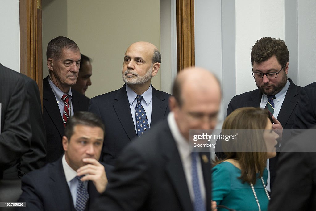 Ben S. Bernanke, chairman of the U.S. Federal Reserve, top center, arrives to a House Financial Services Committee hearing in Washington, D.C., U.S., on Wednesday, Feb. 27, 2013. Bernanke signaled the Fed is prepared to keep buying bonds at its present pace as he dismissed concerns record easing risks sparking inflation or fueling asset price bubbles. Photographer: Andrew Harrer/Bloomberg via Getty Images