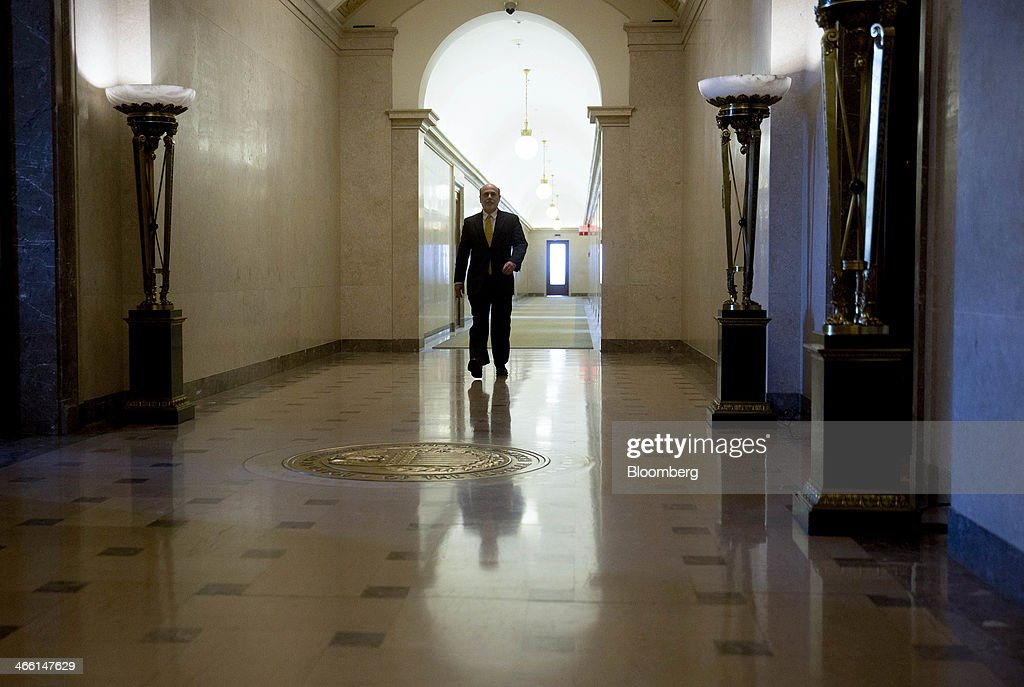 Ben S. Bernanke, chairman of the U.S. Federal Reserve, walks out of his office towards an elevator at the Federal Reserve in Washington, D.C., U.S., on Friday, Jan. 31, 2014. Janet Yellen takes over as Fed chairman beginning Feb. 1, succeeding Ben S. Bernanke, whose eight-year tenure ends today. Photographer: Andrew Harrer/Bloomberg via Getty Images