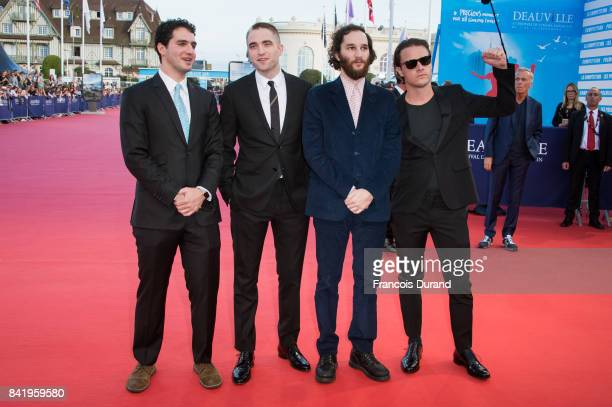 R Ben Safdie British actor Robert Pattinson Joshua Safdie and Oscar Boyson arrive for the screening of the film 'Good Time' during the 43rd Deauville...