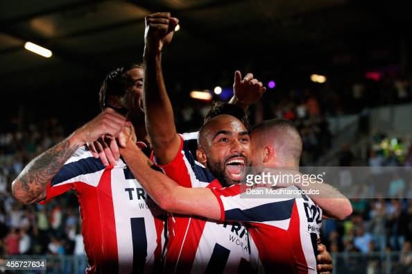 Ben Sahar of Willem II celebrates scoring the first goal of the game with team mates Samuel Armenteros during the Dutch Eredivisie match between...