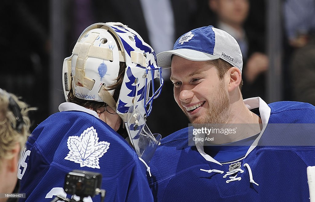 Ben Scrivens #30 and James Reimer #34 of the Toronto Maple Leafs celebrate the teams win over the Florida Panthers during NHL game action March 26, 2013 at the Air Canada Centre in Toronto, Ontario, Canada.