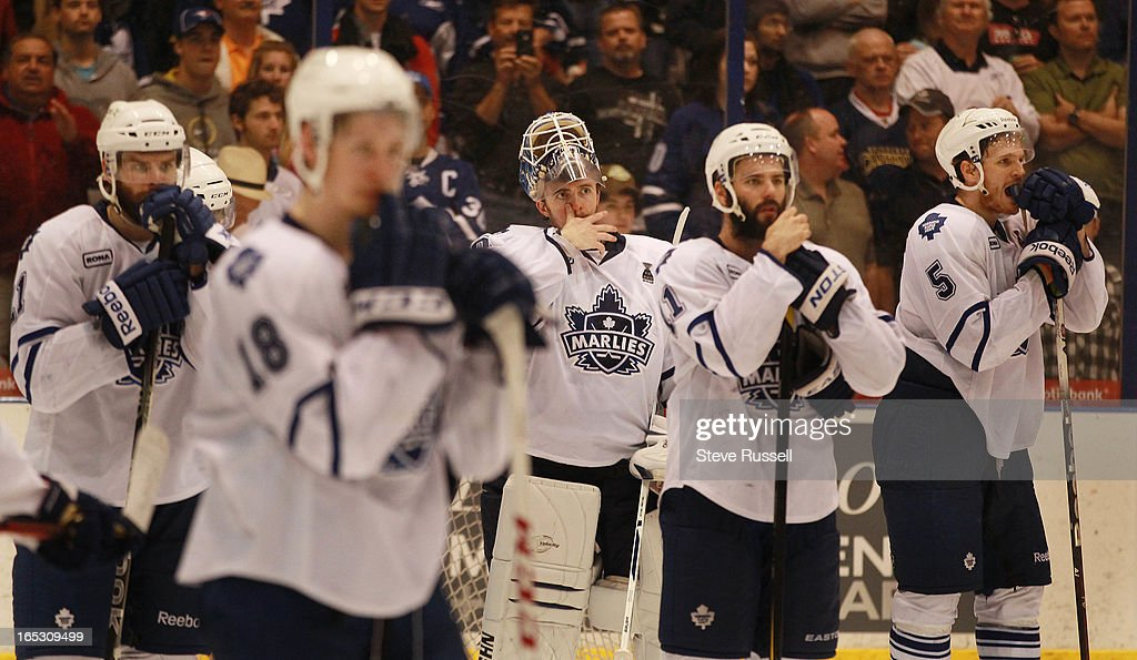 Ben Scrivens centre wipes his face after the Norfolk Admirals beat the Toronto Marlies 61 to win the Calder Cup in four straight games at the Ricoh...