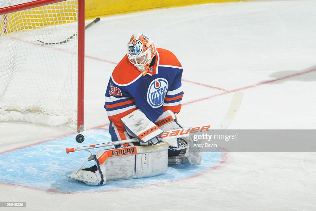 <a gi-track='captionPersonalityLinkClicked' href=/galleries/search?phrase=Ben+Scrivens&family=editorial&specificpeople=7185205 ng-click='$event.stopPropagation()'>Ben Scrivens</a> #30 of the Edmonton Oilers can't make the stop in overtime in a game against the Ottawa Senators on November 13, 2014 at Rexall Place in Edmonton, Alberta, Canada.