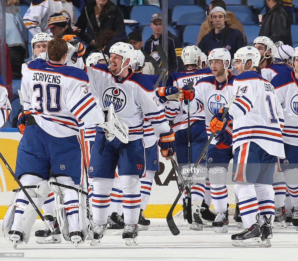 <a gi-track='captionPersonalityLinkClicked' href=/galleries/search?phrase=Ben+Scrivens&family=editorial&specificpeople=7185205 ng-click='$event.stopPropagation()'>Ben Scrivens</a> #30 of the Edmonton Oilers celebrates a 3-2 victory over the Buffalo Sabres with a high five to teammate <a gi-track='captionPersonalityLinkClicked' href=/galleries/search?phrase=Matt+Hendricks&family=editorial&specificpeople=4537275 ng-click='$event.stopPropagation()'>Matt Hendricks</a> #23 at First Niagara Center on February 3, 2014 in Buffalo, New York.