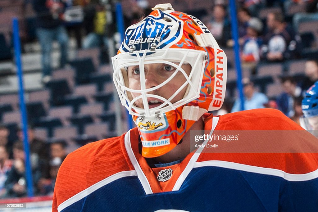 Ben Scrivens of the Edmonton Oilers debuts a new mask paying tribute to those who live with schizophrenia prior to a game against the Tampa Bay...