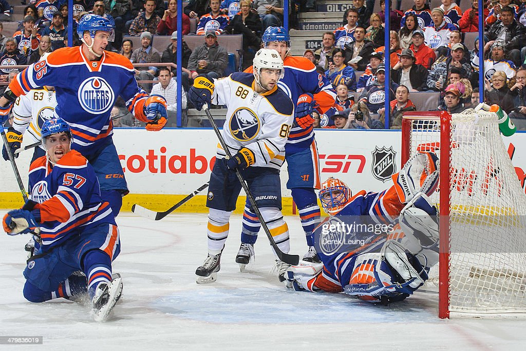 <a gi-track='captionPersonalityLinkClicked' href=/galleries/search?phrase=Ben+Scrivens&family=editorial&specificpeople=7185205 ng-click='$event.stopPropagation()'>Ben Scrivens</a> #30 of the Edmonton Oilers fails to stop the shot of <a gi-track='captionPersonalityLinkClicked' href=/galleries/search?phrase=Drew+Stafford&family=editorial&specificpeople=220617 ng-click='$event.stopPropagation()'>Drew Stafford</a> (not pictured) of the Buffalo Sabres during an NHL game at Rexall Place on March 20, 2014 in Edmonton, Alberta, Canada. The Sabres defeated the Oilers 3-1.
